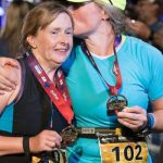 Photo of Diane and Kory at the Ironman finish line