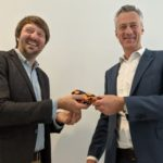 Photograph of Jesper Klein handing the symbolic DAISY tie to Maarten Verboom
