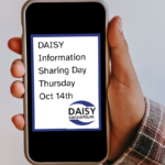 """Photo of a mobile phone showing """"DAISY Information Sharing Day Thursday Oct 14th"""""""